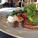 Avocado toast with pistachio dukkha, feta, sun dried tomato & olives, poached egg