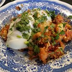 Shakshuka, savory wonder with chickpeas and poached eggs, part of Always Hungry? menu