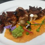 Tenderloin of Pork with wood-roasted mushrooms and merlot sauce with sweet potato mash.
