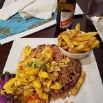 Red Stripe, jerk fries and salt fish with rice and peas