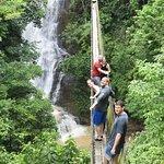 Hanging bridge over the waterfall
