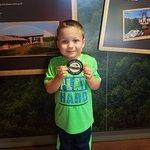 Taking the Junior Ranger Oath w/ badge @ center