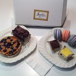 Mixed berry tart, chocolate layered torte, macaroons (lavender-lemon & strawberry), & petit-four