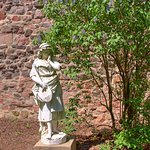 This is just one of the statues that is a open area that is surrounded by brick walls.