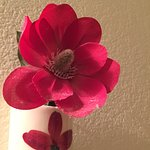dirt on cheap plastic flowers