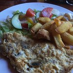 Mushroom omelette with chips and salad