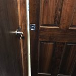 """The unavoidable almost 2 inch gap with the bathroom pocket doors """"closed"""". Impossible to lock."""
