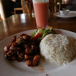 Creole dish with octopus and fruit smoothie