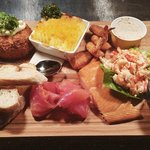 Seafood lovers sharing platter for 2
