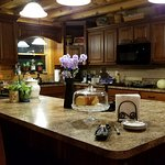 Kitchen with fresh cake available.