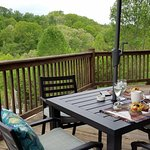 A lovely breakfast on the deck overlooking woods and pool.