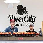 Proprietors of River City Outpost greet a tour group