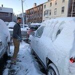 Staff helping me get snow off car