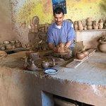 An impressive pottery artisan at work.