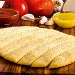 Breadsticks sprinkled with Parmesan.