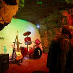 "Stage where famous bands played gigs during the caves' heyday as an ""underground"" party venue!"