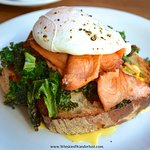 The Smoked Salmon Eggs Benedict with buttered kale and Hollandaise on crusty bread.