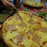 Ham & Pineapple Pizza in the front, with the Massaman Curry Pizza in the background.