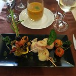 homemade tomato soup and scallops with fresh grilled vegetables