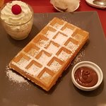 Hot Belgian waffle with nutella and cream
