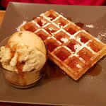 Hot Belgian waffle with salted caramel ice-cream and caramel sauce