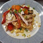 Grilled Chicken with tomato goat cheese couscous. Seasoned veggies with a lemon bacon vinaigrett