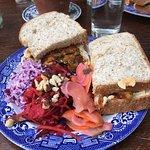 Hummus and veg sandwich with salads
