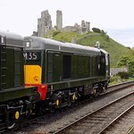 Class 20 at Corfe Castle station with the said castle in the background.