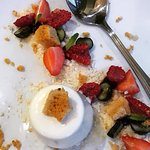 Salted caramel panna cotta with crumb and berries