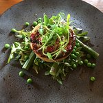 Feta, spinach and red pepper tart on asparagus and pea salad