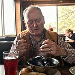 Bob digs into a pound of Penn Cove mussels with garlic bread