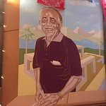 Nice mural at our table of the late owner.