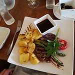 Steak with red wine sauce and roast potatoes