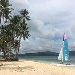 Our mini catamaran moored on the beach of a nearby island