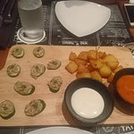 Two of the complimentary tapas with glass of wine.