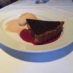 Chocolate torte with raspberry sauce and salted caramel sorbet.