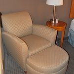 Chair and ottoman in the room