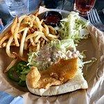 Catfish Po' boy sandwich with olive fries