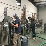 Distillers Shane and Josh mashing some Stave Robber bourbon