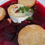 Roasted beet root with goat cheese, cardamom, cashews, and potato pancakes