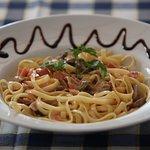 Special pasta with ham bacon mushrooms and milk-cream sauce.