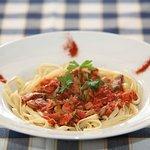 Plus minus pasta with tomato sauce ham bacon mushrooms .