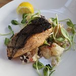 Charred salmon with pea shoots and mediterranian potatoe salad (warm)