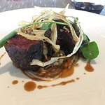 bison rib eye + short rib burdock root, garlic scapes, evergreen cream, crispy daisy capers + wi