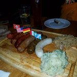 Sausage sampler - 6 different sausages with potato salad and kraut. Awesome!