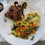 pork chop with sautéed mushrooms, veggies, mashed potatoes