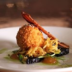 A scotch egg - with a difference! A soft boiled quails egg encased in slow braised pig's cheek.