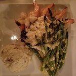 Filet Mignon, oscar topped with a side of shrimp, asparagus and mashed.