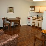 all 1 bedroom suites have a full kitchen, tvs in both living area and bedroom, free wifi