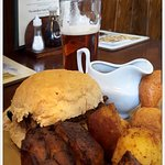 hot beef roll, served with gorgeous roast potatoes, Yorkshire pudding and great gravy !